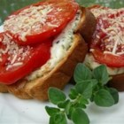 Mama's Best Broiled Tomato Sandwich - Fresh, ripe tomatoes are marinated in olive oil and balsamic vinegar, then broiled with Parmesan cheese on toast.  Serve warm with a bowl of soup, if desired.