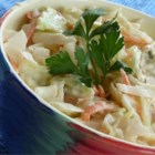 Bleu Cheese Coleslaw - Coleslaw with a TWIST! If you're a bleu cheese lover, you'll LOVE this recipe. It's the first thing people come back for 2nds of at all our holiday functions. It's easy and refreshing.