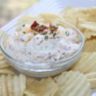 Baked Potato Dip II  - Classic toppings including sour cream, Cheddar cheese, green onions, and bacon are mixed up in this family-friendly appetizer. Serve this dip with thick cut potato chips for even more baked potato flavor.