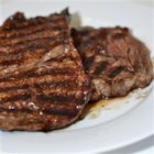 Garlic Pepper Steak - An easy garlic and pepper rub lightly adorns juicy slabs of steak.