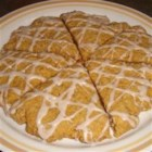 Pumpkin-Oat Scones - These iced scones with oats and pumpkin puree are seasoned with cinnamon, nutmeg, ginger, and cloves.
