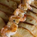 Grilled Shrimp and Apple Skewers - Shrimp and apples are marinated in a sweet and spicy sauce, then skewered and grilled.  Serve over white rice, noodles, or a mixed green salad.