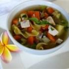 Hearty Chicken Vegetable Soup I - Chicken, tortellini and egg noodle soup with carrots, yellow squash, zucchini, mushrooms, and bell pepper.