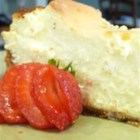 SuzyQ's Elegant Cheesecake - This lovely, rich cheesecake has a hint of lemon flavor. Make it the day before, so it can bake and chill overnight. Then serve with your favorite topping.