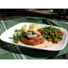 Jagerschnitzel - Pork cutlets are pounded thin, breaded, and fried, then topped with a sour cream-mushroom gravy.