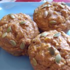 Spiced Pumpkin Molasses Muffins - Perfect for any fall gathering, these spicy pumpkin muffins with the deep, rich flavor of molasses are made with whole wheat flour, flax, yogurt, and applesauce.