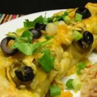 Green Chicken Enchilada - Very easy to make! Chicken and Monterey Jack Cheese filled flour tortillas topped with green enchilada sauce. I make Mexican Rice to serve on the side.