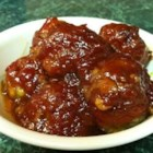 Baked BBQ Meatballs - A sweet, tangy sauce gives these meatballs a wicked delicious taste that guarantees an empty dish at potlucks and several requests for the recipe.