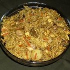 Singapore Noodles - Chicken, noodles, mushrooms, and water chestnuts soak up a rich peanut butter sauce in this addictive dish.