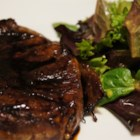 Teri Tips - Cubed beef steak is marinated in soy sauce, sesame oil, and sugar for at least 4 hours. The meat is sauteed and added to the reduced marinade along with chopped green onions and white wine.