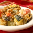 Zucchini Casserole II - Zucchini baked with mushroom soup, sour cream, onions and carrots and topped with buttery stuffing.