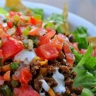 Southwestern-Flavored Ground Beef or Turkey for Tacos & Salad - With Southwestern-Flavored Ground Beef, you can simultaneously make tonight's dinner and tomorrow's lunch. Just save out and refrigerate some of the taco meat and fixings such as shredded cheese and lettuce, plus chopped scallions and tomatoes. A good-looking salad like this will draw potential lunch traders. More likely than not, they'll be out of luck.
