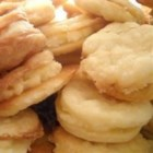 Swedish Waffle Cookies - A creamy lemon-flavored liqueur filling is sandwiched between thin oval-shaped butter cookies for a sweet treat on any occasion. The recipe calls for a strongly flavored Swedish liqueur, but you can use amaretto if you like.