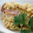 Different Chicken Cordon Bleu - This casserole still features ham and Swiss cheese with chicken, but strays from the original with a sauce of cream soup, sour cream and wine.  Stuffing mix tops the entire creation.
