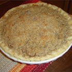 Crumb Apple Pie - Cinnamon and nutmeg are sprinkled between layers of sliced apples, covered with a sweet butter crumble concoction, and baked in a pie shell until the apples are tender and the juices are bubbling through the sugar crumble.