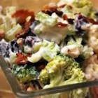 Raw Vegetable Salad - Lots of variety and crunch in this tasty salad.  Spanish peanuts, crumbled bacon, and dried cranberries mingle with fresh broccoli, cauliflower, and celery. The whole shebang is tossed with a mayonnaise, vinegar and oil dressing with a hint of sugar and grated onion.