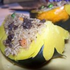 Venison and Wild Rice Stuffed Acorn Squash - Spiced venison and wild rice make up the stuffing for these baked acorn squash.  This makes an unusually good one-dish main course.