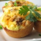 Breakfast Pies - A biscuit crust filled with sausage, eggs, and cheese. These individual breakfast pies can be made ahead of time, and microwaved as needed.