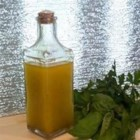 Lite Italian Salad Dressing - This homemade salad dressing with apple cider vinegar and corn oil is great on both tossed green salads and pasta salads.