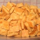 Cheese Straws - To make this tasty holiday snack, combine shredded Cheddar cheese with butter, flour and salt.  The dough is rolled out and cut into strips then baked until crispy.  Use sharp or mild cheddar, your choice.