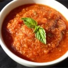 Homemade Tomato Sauce I - Fresh tomatoes slowly cook with onion, green pepper, garlic, and red wine in this rich, flavorful sauce.