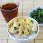Quick Oyakodon - Chicken and onion are cooked with scrambled eggs and served over rice in this Japanese favorite.