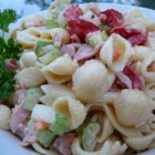 Macaroni Salad with a Twist - Seashell pasta tossed with chopped carrots, green bell pepper, celery, and cooked ham in a lively mustard-mayo-white vinegar dressing is a flavor-packed variation on traditional macaroni salad.
