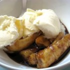 Bananas Foster II - Bananas are cooked in a bubbling pan of dark brown sugar, butter, rum and cinnamon and served over ice cream with walnuts in this elegant, quick dessert.