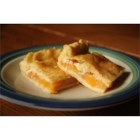 Peach Finger Pie - This big rectangular peach pie is baked in a jelly roll pan and sliced into squares for serving. The thick filling sets up and the slices can be eaten with your fingers.