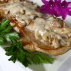 Mushroom Pork Chops - Transform cream of mushroom soup into a delicious simmering sauce by tossing in some chopped onion and sliced fresh mushrooms. Add to seasoned and sauteed pork chops and you have a rich and creamy meal.