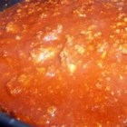 Chili Without The Beans - Ground beef and potatoes are cooked in a rich tomato sauce seasoned with chili powder, garlic and hot pepper sauce to create this meaty chili.