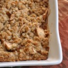 Apple Crisp I - Apples are topped with a brown sugar, instant oatmeal crust, sprinkled with walnuts, drizzled with maple syrup and baked until tender.