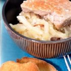 Shirred Potatoes and Pork Chops - Pork chops and shredded potatoes, topped with a homemade white sauce, bake slowly in the oven to make a comfort-food casserole for a winter's night. You can add cheese, onion, or just about anything to make this recipe your own.