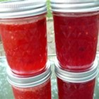Budget Berry Jam - Need another way to use green tomatoes?  Puree them and heat with sugar and fruit flavored gelatin (use your favorite flavor!) and you've got freezer jam.