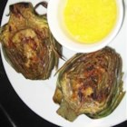 Grilled Garlic Artichokes - No more dipping artichokes in mayo! These artichokes are grilled with a lemon garlic basting sauce. This is the best way to eat artichokes.