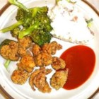 Alligator Fingers - Great appetizers for sporting events, these deep-fried alligator pieces are exotic, but they taste like chicken. You can get frozen alligator meat online. Try them with the optional dipping sauce.