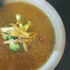 Azteca Soup - Tomatoes, chipotles and cilantro are cooked in chicken broth and pureed in this soup which is garnished with cubes of avocado and freshly fried strips of corn tortillas.