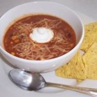 Becca's Taco Soup - Taco ingredients such as browned ground beef, onion, corn, kidney beans and a package of seasoning mix are combined in this soup which may be garnished with grated cheese.  Serve with tortilla chips.