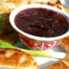 Plum Sauce - Plum jam is cooked with vinegar, brown sugar, garlic and spices to create a sauce that you can serve hot or chilled, with egg rolls, pork or chicken.