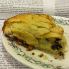 Apfelkuchen - Apples and raisins are arranged over the top of a buttery cake before baking to make a beautiful and sweet dessert.
