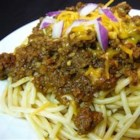 Skyline Chili II - This is a dark red, spicy meat chili made with browned ground beef, tomato paste, crushed chili peppers, cinnamon and allspice. Serve over cooked pasta with a generous sprinkling of grated Colby cheese.