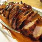 Tangy Grilled Pork Tenderloin - A sweet and spicy marinated tenderloin, grilled to perfection.