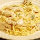 Chicken Alfredo with Fettuccini Noodles - This is a rich and creamy Alfredo sauce of butter, ricotta cheese, cream and Parmesan cheese.  It's served with fettuccini and sauteed chicken.