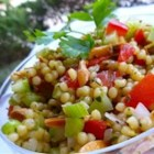 Almond Citrus Couscous - Light Mediterranean flavors of toasted almonds and lemon peel flavor this cold pasta salad that features Israeli (pearl) couscous.