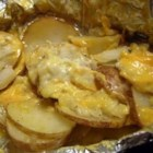Cheesy Campfire Potatoes - These easy cheese potatoes are great over the grill or campfire.  And since they're in a foil packet, there's no mess to clean up!