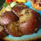 Oven Roasted Red Potatoes - Red potatoes are coated with olive oil and a package of onion soup mix before roasting in a hot oven for one hour.