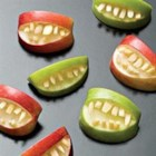 Halloween Fruit Apple Teeth Treats - These cute snaggle-toothed apple snacks contain nothing but fresh apples and slivered almonds, and kids love them.