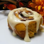 Kelsandra's Pumpkin Cinnamon Rolls - These sweet rolls are made with pumpkin and pumpkin pie spice, then glazed with a cream cheese frosting. They're perfect for a special fall or winter brunch.