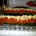Italian Meatloaf in Zucchini Boats - Meatloaf with Italian flavors is baked inside hollowed-out zucchini boats, and topped with spaghetti sauce and melted mozzarella cheese.