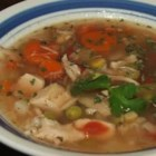 Turkey Carcass Soup - Get every last bit of turkey goodness from your turkey by making broth from the carcass and simmering it into a hearty soup with lots of delicious vegetables and barley.